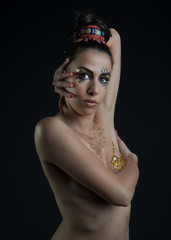 woman with Egyptian make-up on dark background