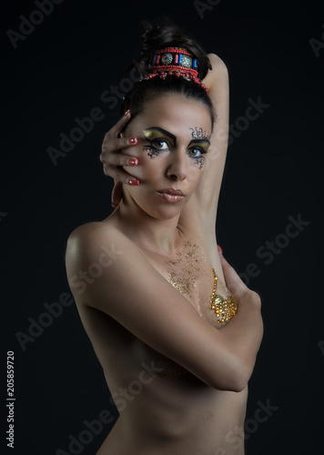 Fotobehang Kapsalon woman with Egyptian make-up on dark background
