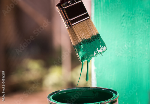 Painting metal surface with a brush