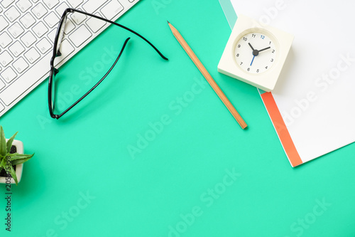 Top view of office desk with stationery items
