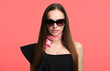 brunette woman is wearing sunglasses