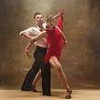 Leinwanddruck Bild - Flexible young modern dance couple posing in studio.