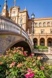 Bridge and flowers on plaza de Espana spain square in Sevilla