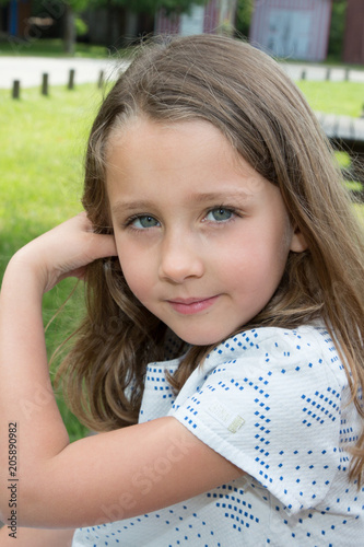 pretty young kid girl outdoor portrait in home garden day