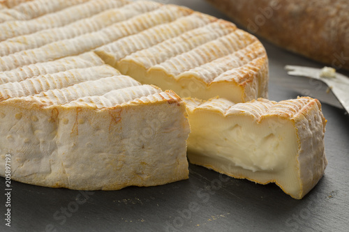 Fototapeta French Le Marcaire cheese on a cheeseboard