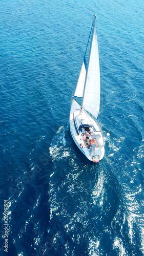 Fotobehang Zeilen Aerial birds eye view from drone of yacht in deep blue sea