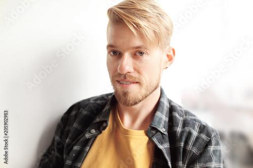Portrait of trendy hipster indoors