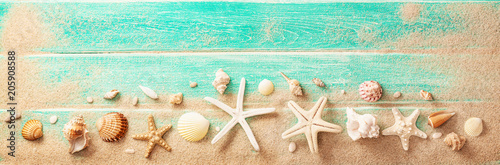 Beach Accessories With Seashells On Wooden Board. Summer Holidays - 205908588