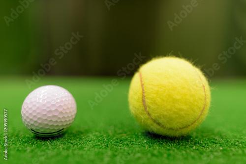 Fotobehang Tennis Golf Ball And Tennis Ball On Green Surface