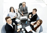 successful businessman and his business team meeting in modern office - 205920329