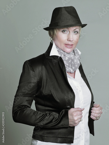 portrait of a scandalous woman in a black hat