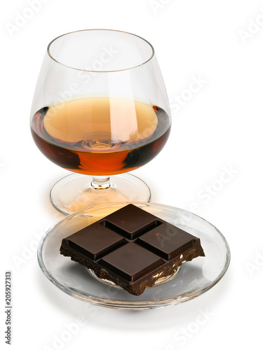 Cognac and chocolate in a glass saucer