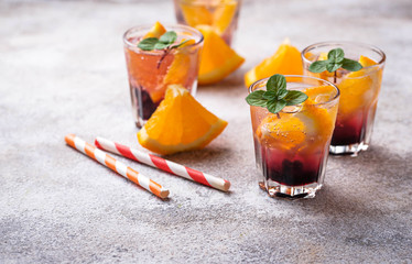Summer  drink with orange and berries