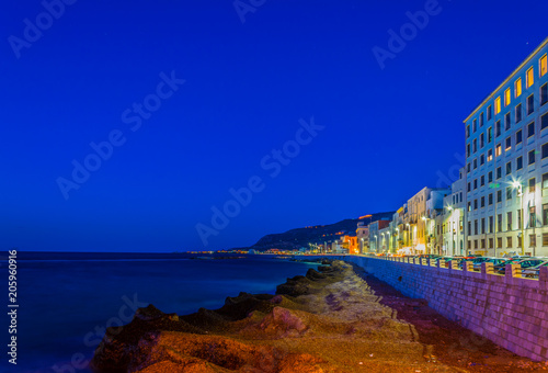 Fotobehang Donkerblauw View of seaside of the sicilian city Trapani and Erice village on the hilltop during sunset, Italy