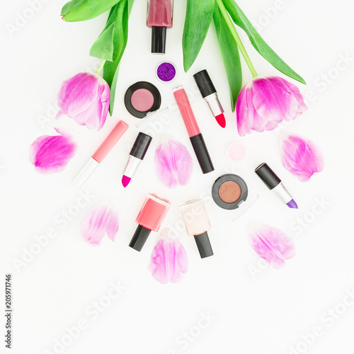 Leinwanddruck Bild Cosmetic composition with pink tulip flowers bouquet and cosmetics on white background. Top view. Flat lay. Home feminine desk.