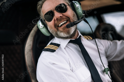 Smiling helicopter pilot with headset