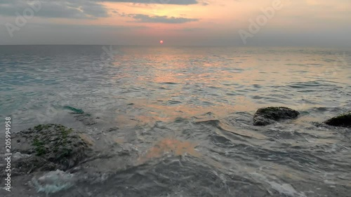 Flying over coast and waves at sunset. Aerial 4k video nature seascape.