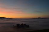 tramonti montani e nebbie