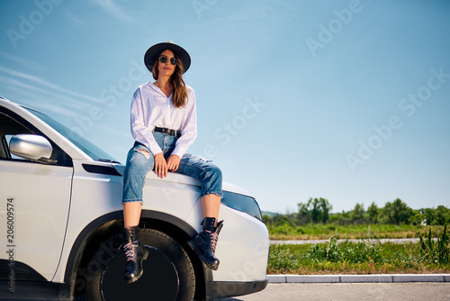 Girl sitting on the car.