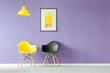 Contrasting color chairs against wall