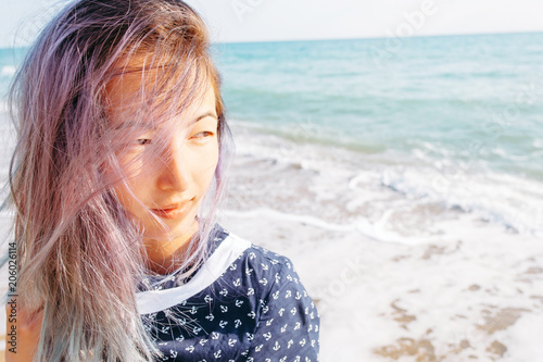 Fotobehang Kapsalon Portrait of girl on background of sea.