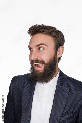 Childish bearded man in suit