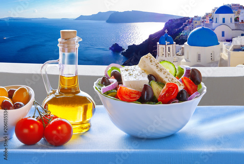 Aluminium Santorini Greek salad against famous church in Oia village, Santorini island in Greece