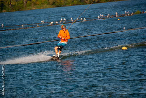 Wakeboarder makes a turn while training