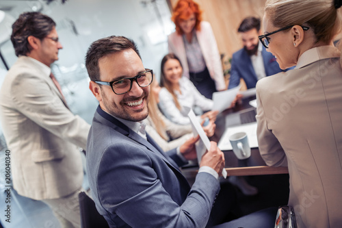 Poster Business people having meeting in modern office