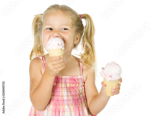 Ice Cream: Little Girl Holding and Eating Two Ice Cream Cones