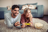 Young couple playing video games - 206041104