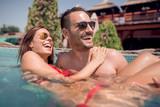 Couple having fun in a swimming pool - 206041129