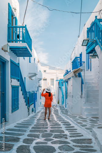 young woman on vacation at the Greek island Mykonos or Mikonos Greece