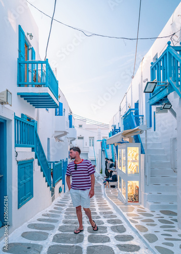 young man on vacation at the Greek island Mykonos or Mikonos Greece on a bright summer day