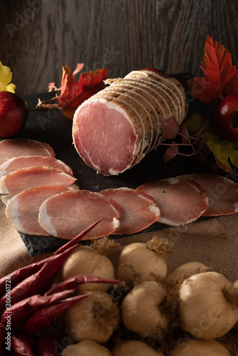 Wall mural Assortment of various meat and sausages on wooden table