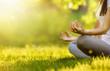 Leinwanddruck Bild - Yoga woman meditating at sunset. Female model meditating in serene harmony