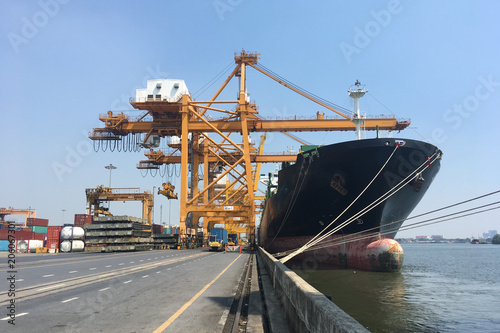Aluminium Bangkok Container ship is berthing at wharf for cargo operation during day time.