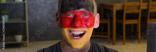 Cheerful male fan with painted face