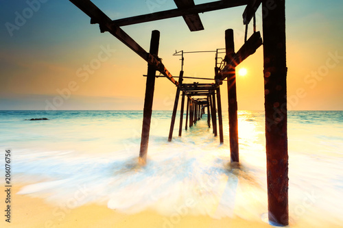 Fotobehang Strand Wooden bridge on the Patong beach at sunset in Phuket,Thailand
