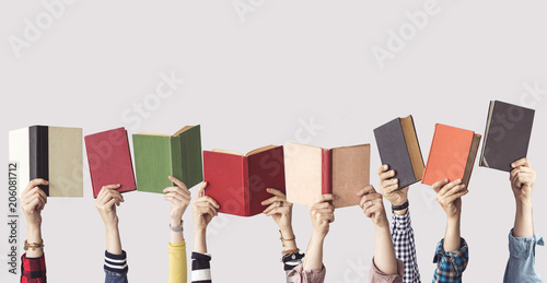 The hands of people hold books © sebra