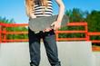Girl with skateboard on ramp