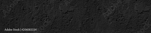 panorama front-end czarny beton nierówny popękany tło