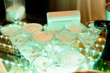 Champagne wine chrystal glasses set in night club bar at expensive luxury restaurant cocktail party wedding celebration - 206084910