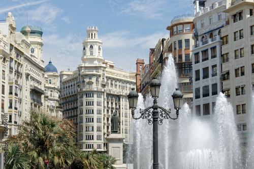 Valencia Plaza Ayuntamiento, view of the statue of Francesco de Vinatea and skyline of the Plaza del Ayuntamiento, Valencia, Spain.