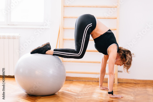 Poster Woman exercise with pilates ball