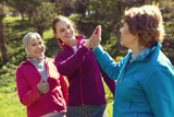 Healthy lifestyle. Delighted sportive woman smiling and giving a high-five to her trainee - 206087709