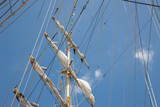 Ropes and Cleats on the Bow of a Wooden Sailboat - 206098579