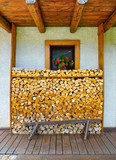 Neatly stacked wooden logs - 206114982