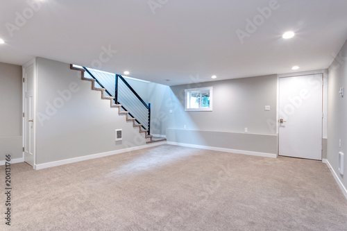 Leinwandbild Motiv Light spacious basement area with staircase.