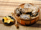 Seafood big oysters plate with lemon and bottle of wine. Diet healthy food. Copy text. - 206135325